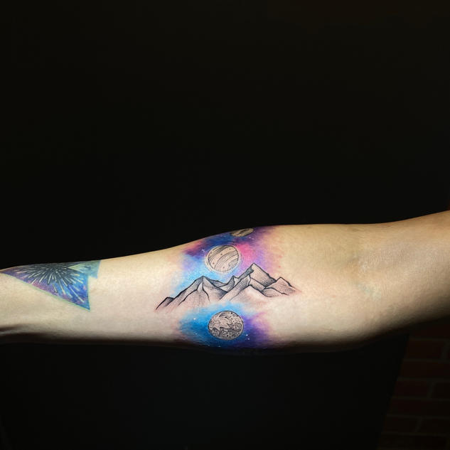 Finished tattoo - planets pass behind the mountains