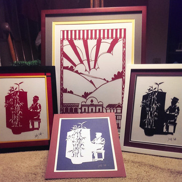 The full set of Sutter Creek pieces: 3 pianists and a papercut of the town itself