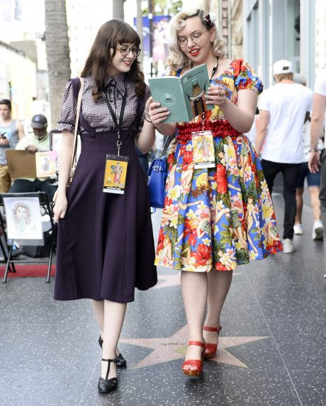 Costumed millennials stroll down Hollywood Blvd during the TCM Film Fest