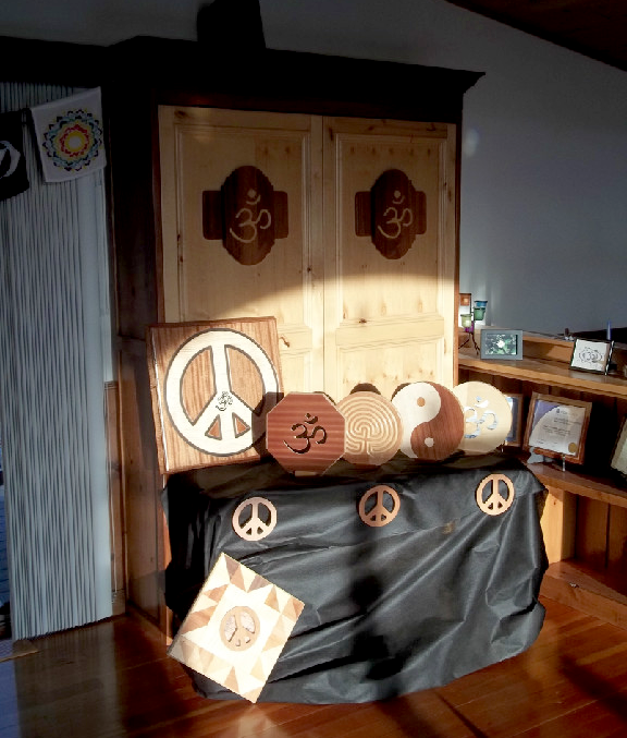 wooden peace sign & wooden aum