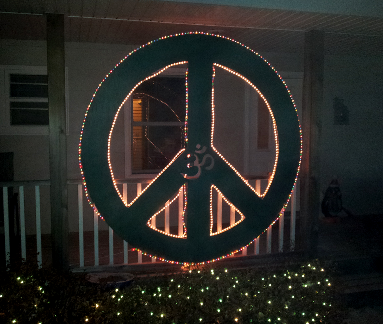 wood peace sign with lights