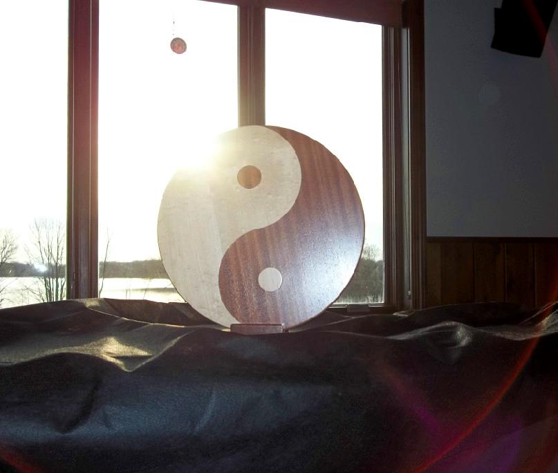 wood yin-yang symbol
