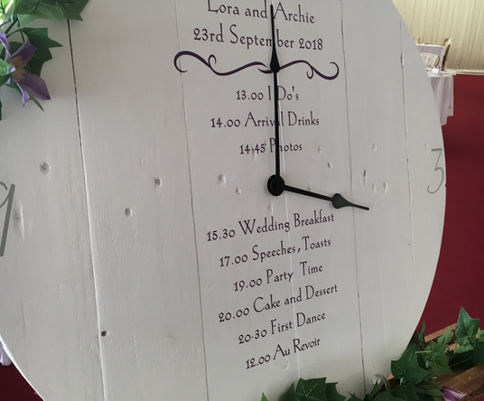 Clock with schedule of wedding day