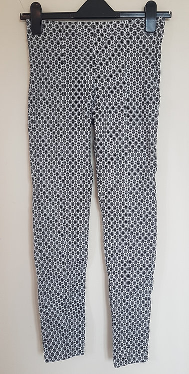 ATMOSPHERE. Black and white patterned trousers with zip side.