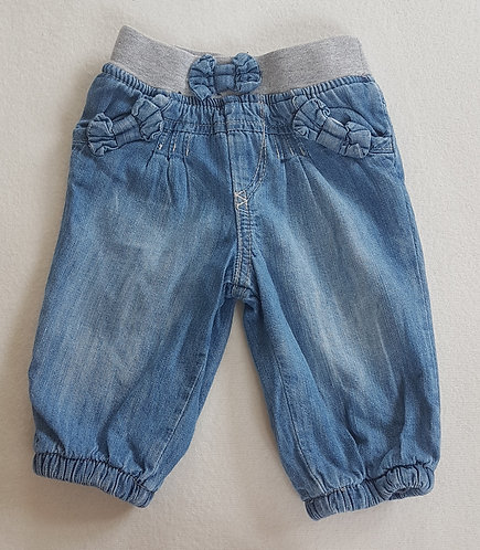 Tu. Denim trousers. Elasticated ankles. Bows on pockets. Soft lining.3-6 months.