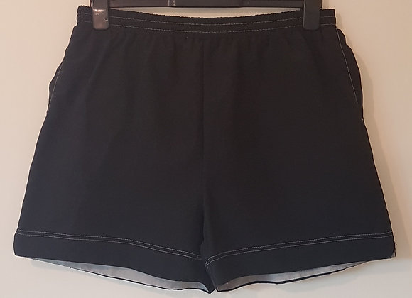 DESIGNED FOR T. Black swim trunks with pockets. Size L