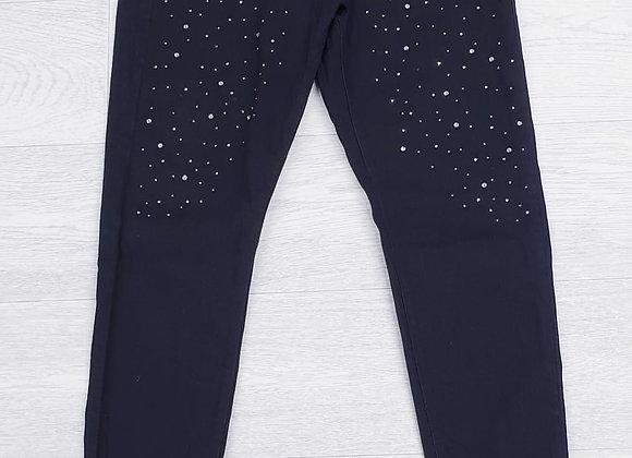 B. You black skinny jeans with gems.