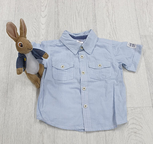 Baby blue short sleeved shirt. 18-24m
