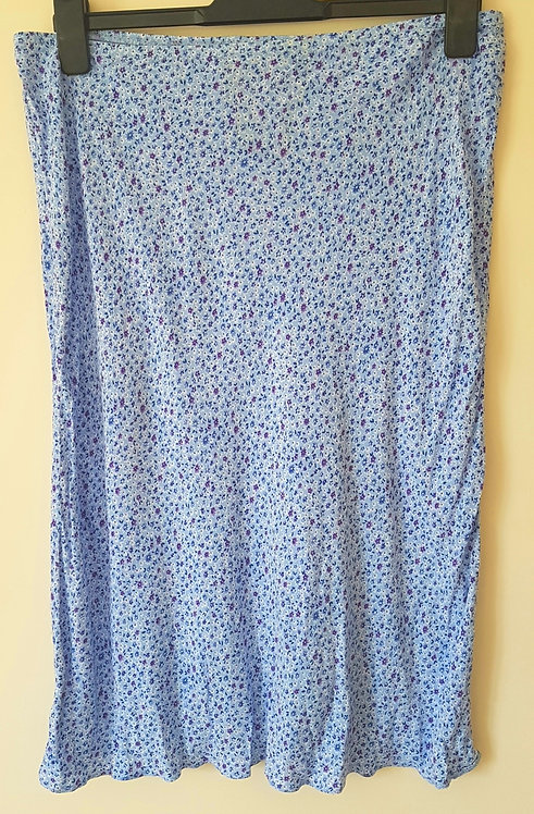 BHS. Blue skirt with small purple flowers. Elastic waist. Size 14.