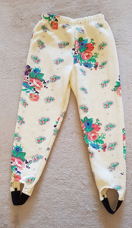 Cream 80/90sfloral stirrup trousers. 65% polyester 35% cotton wash at 40° 4-5yrs