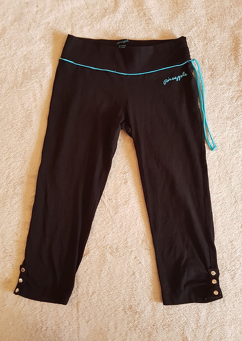 Pineapple. Black 3/4 length sport leggings. 92% cotton. 8% lycra. Size 8.