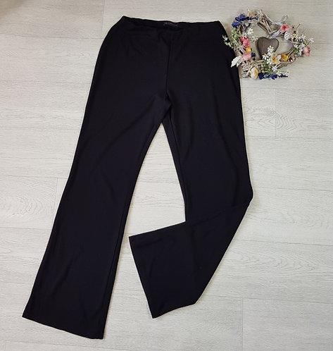 M&S black stretch fit bootcut soft trousers. Size 12L