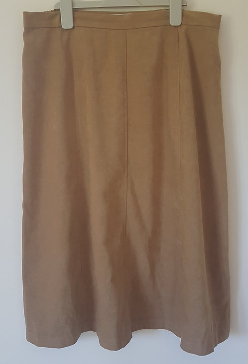 LES IMPECCABLES. Tan knee length skirt. Button and zip back. Size 18.