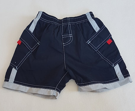 NEXT. Navy swimming trunks. Size 12-18 months. Keep away from fire.