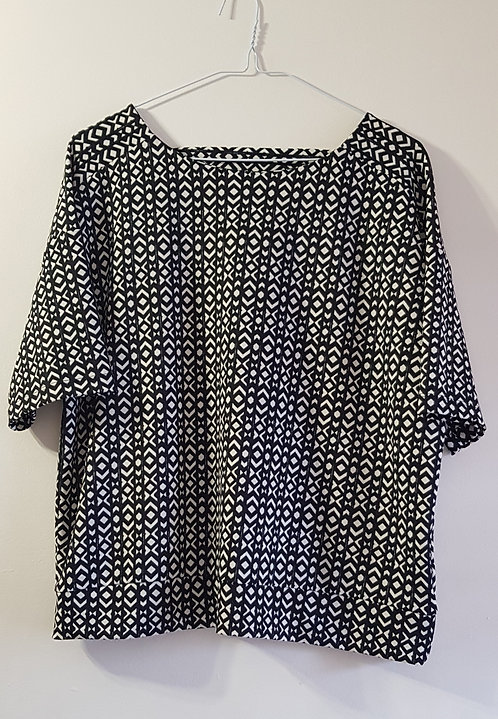 NEXT. Black and white top. Size 14 petite.