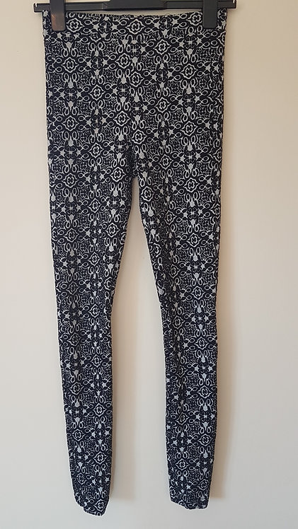 TOPSHOP. Black patterned, stretchy and textured bottoms.