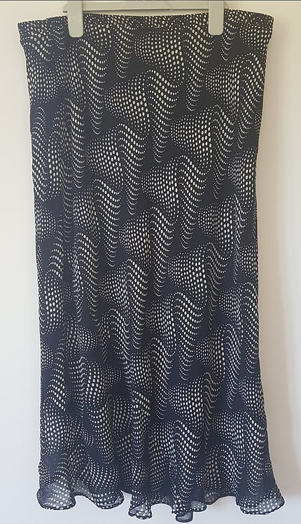 BERKERTEX. Black below the knee skirt with white pattern. Size 18.
