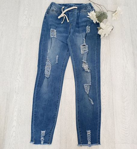 Ripped jeans with elasticated waist. Size M