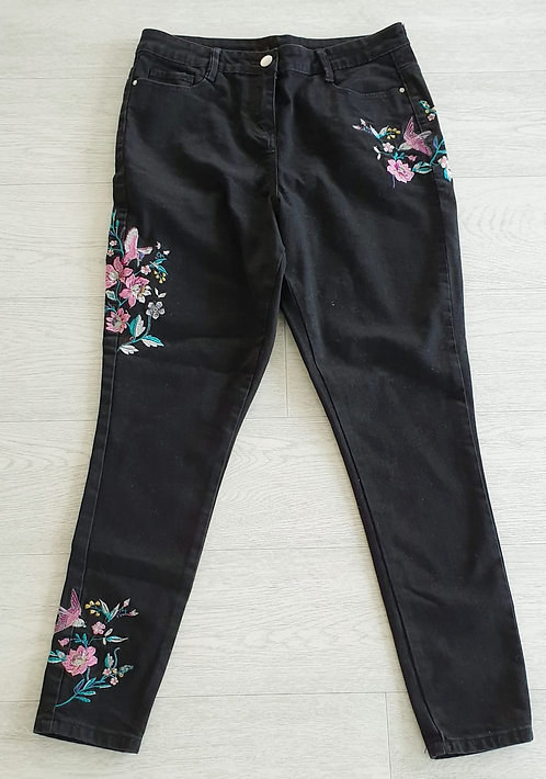 Black embroidered skinny jeans. Size 12
