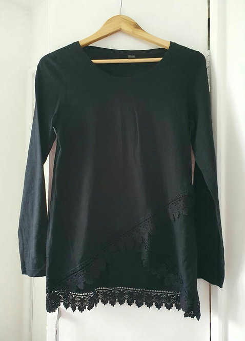 Black top with crocheted hem. Size S
