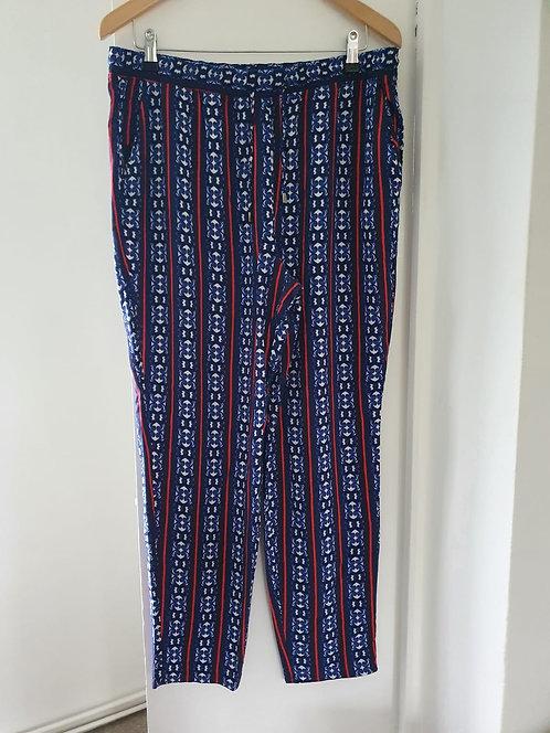■Papaya patterned harem trousers. Size 16