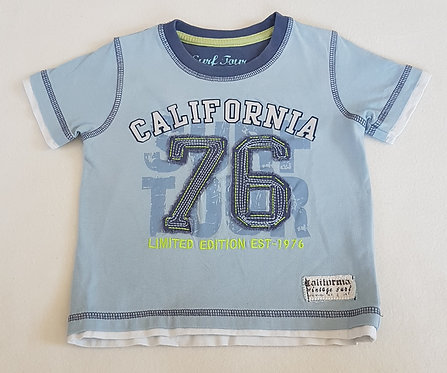 MATALAN. Blue short sleeve top. Size 12-18 months. Keep away from fire.