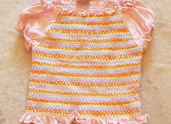Cherokee. Pink multi coloured t-shirt. Keep away from fire. 12-18 months.