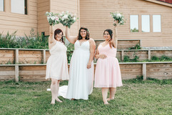 felicia painter, the bride posing with her bridesmaids on her wedding day!