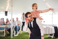 hyped up on the dance floor at a tented michigan summer wedding