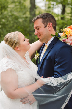 bride and groom embracing at their michigan wedding during portraits