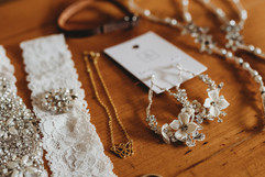 Flatlay styling of michigan brides jewelry for her wedding