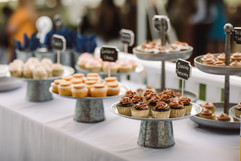 cupcake dessert table at outdoor tented wedding