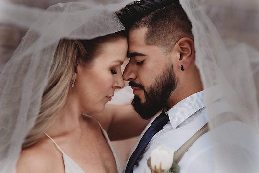 Gorgeous luxury michigan wedding couple giving eskimo kisses