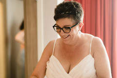 bride smiling as she gets ready