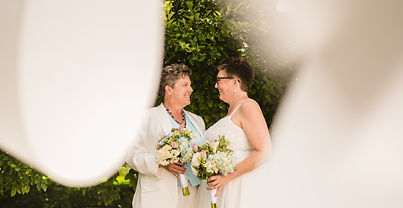 LGBTQ Lesbian wedding couple review muse weddings. This couple booked full service wedding planning in michigan.