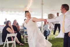 fun couples dance at their michigan wedding on the lake