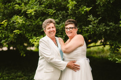 Jackie and Judy the LGBTQ summer coupler holding each other at their wedding in Michigan