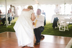 couples first dance on the dance floor outside