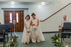 flower girls making their way to the altar at a michigan church wedding ceremony