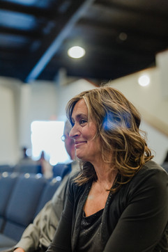 mother smiling at an indoor church wedding ceremony in michigan