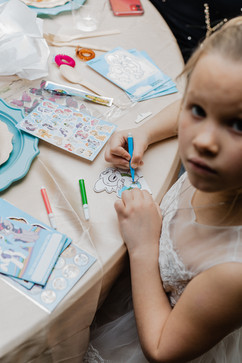 kids playing with coloring kit at indoor michigan wedding