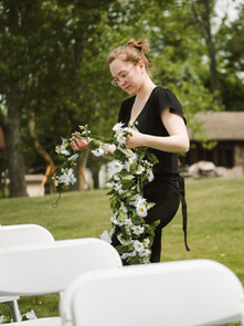 Wedding planning assistant in grand rapids michigan setting up ceremony decor