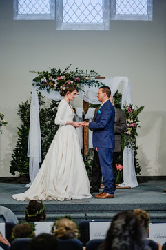 couple exchanging vows at church wedding in michigan