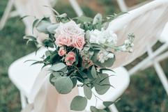 dusty rose and white wedding ceremony aisle decor
