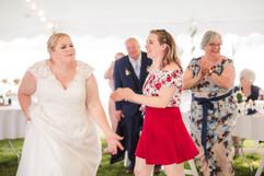 bride having fun at her michigan wedding on the lake