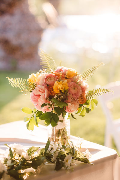 pink and yellow bridal bouquet for an outdoor tented michigan wedding