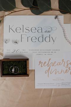 invitation flatlay styling by tascha amond lead planner at muse weddings and michigan wedding coordinator