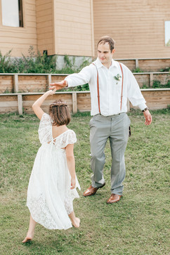 groom dancing with the flower girl. Dad dancing with his daughter at their outdoor michigan wedding