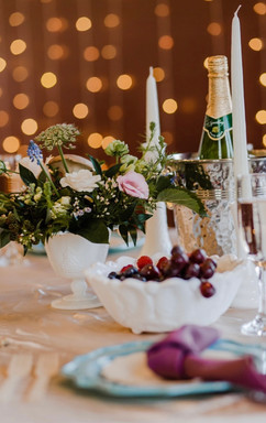 beautiful natural and vibrant table decor at a michigan wedding which features berries, peaches and mushrooms!