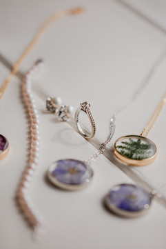photo of brides jewelry with bridesmaids jewelry at indoor wedding